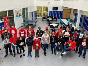 UTC Students and staff with Christmas jumpers on