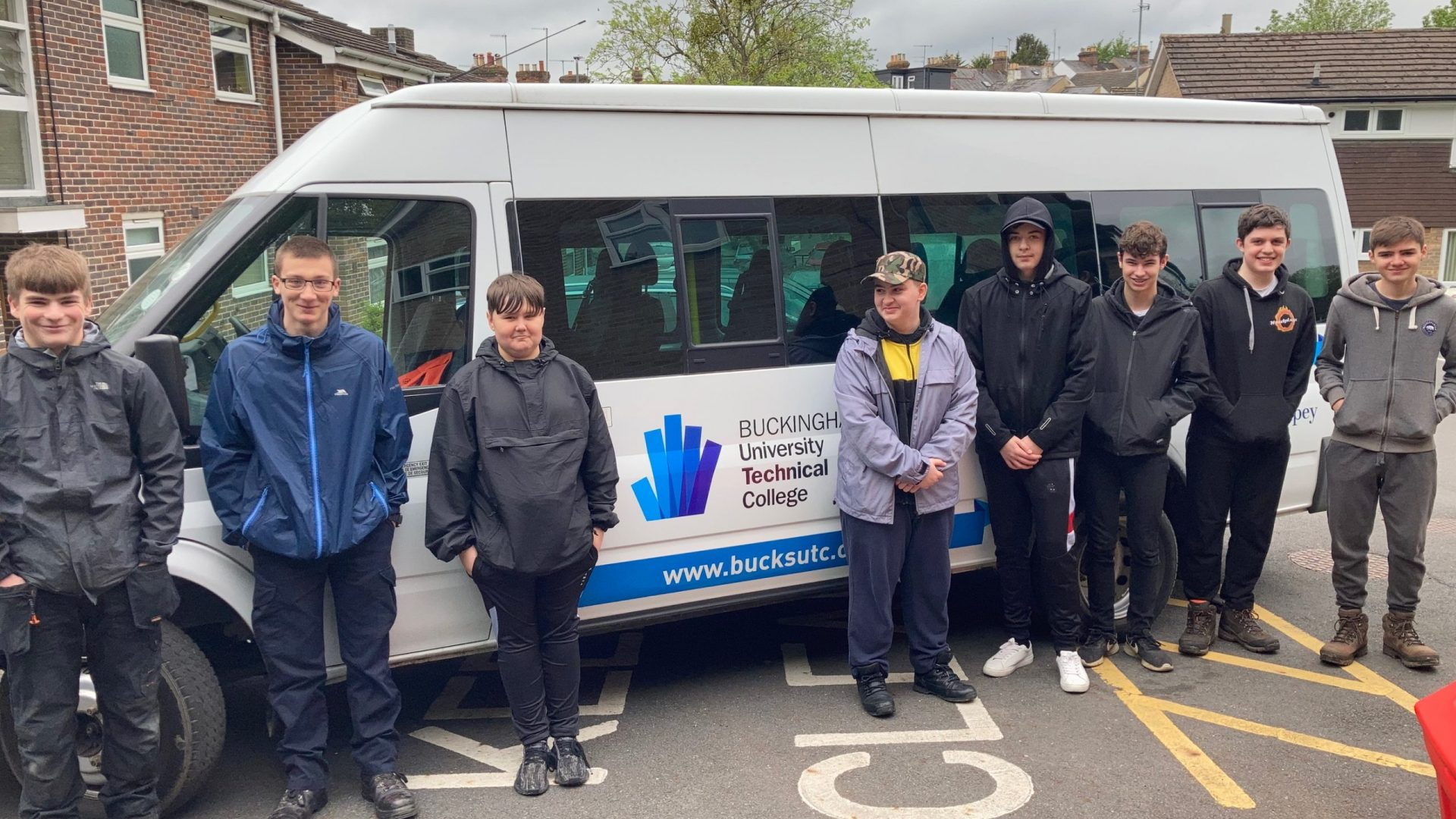 Students stood in front of minibus